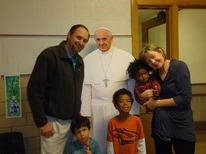 Pope Francis with a family.